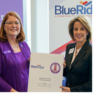 WCU Chancellor Kelli R. Brown (left) and Blue Ridge Community College President Laura Leatherwood display a memorandum of understanding between the two institutions.