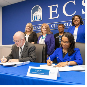 College of the Albemarle President Dr. Robert Wynegar, seated left, joined ECSU Chancellor Dr. Karrie Dixon in signing two agreements. The purpose of the agreements is to build a relationship between the two institutions, and create a clear pathway for COA students to transfer to ECSU.