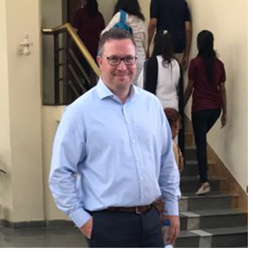 ECSU's Dr. Timothy Goodale, seen here at a conference in India recently, is working on a National Science Foundation funded project to investigate the viral impacts on the cassava plant, a major food source in Africa.