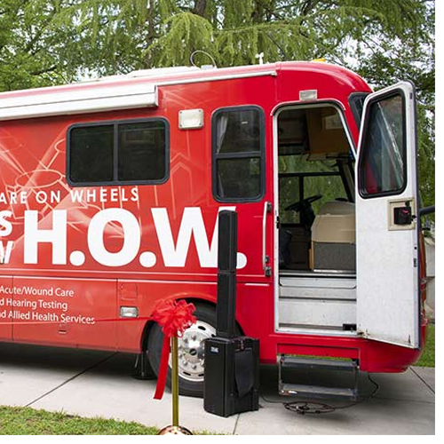 WSSU cuts ribbon for the second university-branded mobile clinic on Thursday, May 17.