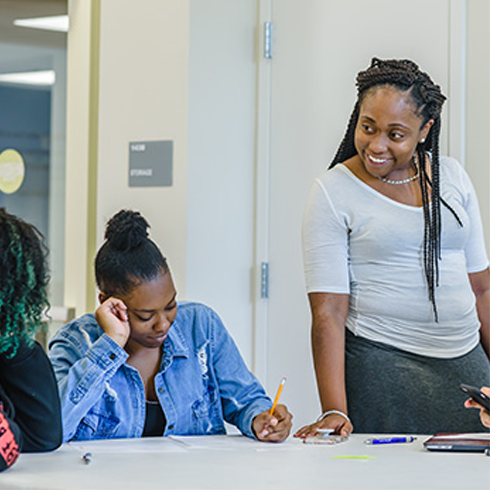 Denisha Bland '13, '15 MEd, assistant director of Frontier Set initiatives, mentors students during a weekly Spartan StartUp workshop.