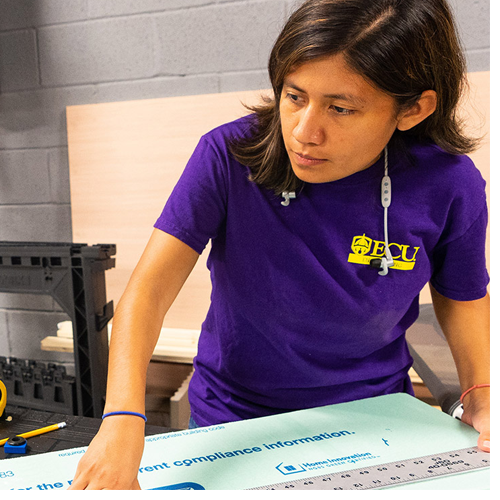 Jessica Vargas Hernandez helps build the helicopter simulator with other interns. (Photos by Cliff Hollis)