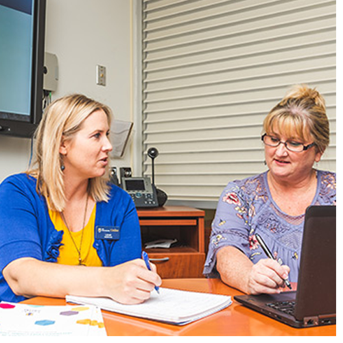 BIPS coaches Leah Tompkins (left) and Angi Kinsey (right) work virtually with students on a regular basis to keep them on track for graduation.