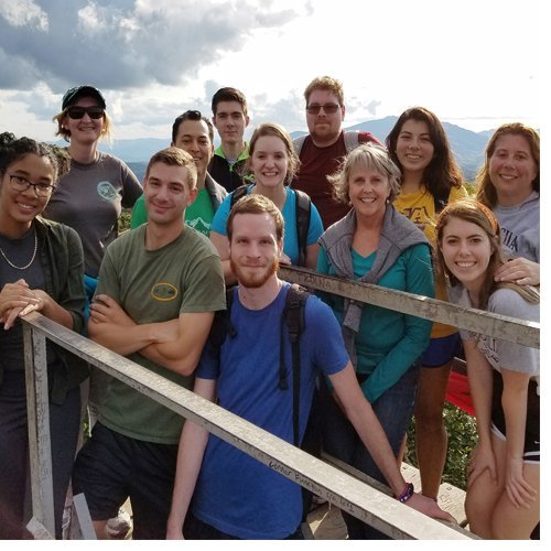 Director of Transfer Services Jane Rex joins the transfer residential learning community for a hike to the fire tower on Flat Top Mountain near Boone.