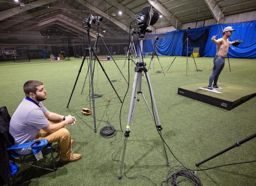 A pitcher stands in front of the cameras that will record his motion