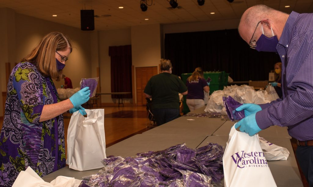 University employees prepare face coverings to distribute