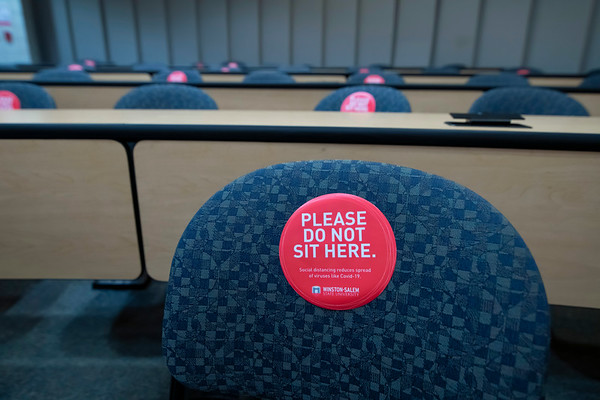 Classroom chairs marked for physical distancing