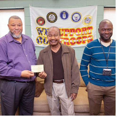 ECSU's Military and Veterans Affair Center director, Tim Freeman, left, announced the opening of a food pantry located in the facility's Griffin Hall office. The pantry will assist members of the Coast Guard effected by the current partial government shutdown. ECSU alumni and Elizabeth City businessman, Billy Joe Reid, center, donated $1,000 to the pantry. Joining Freeman and Reid is Veterans Affairs representative Jamal Blyther.
