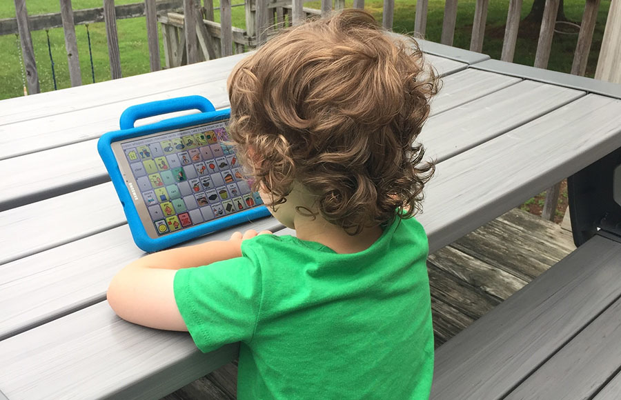 3-year-old uses an augmentative and alternative communication (AAC) device